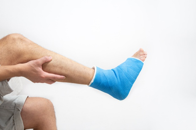 blue-splint-ankle-bandaged-leg-cast-male-patient-white-background-isolated-sports-injury-concept_169016-7237