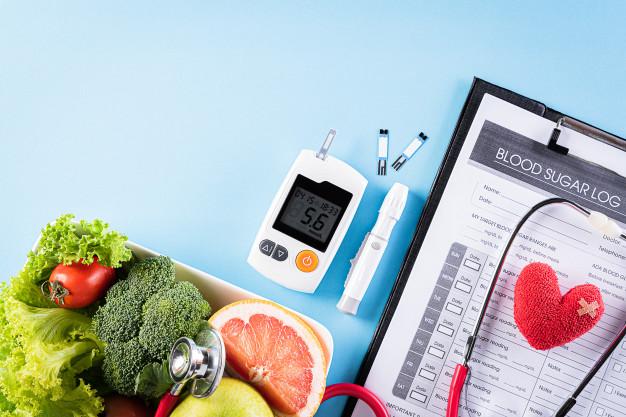 diabetes-set-healthy-food-blue-wall_53476-5141