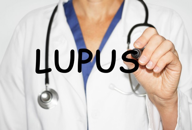 doctor-writing-word-lupus-with-marker-medical-concept_132358-2926