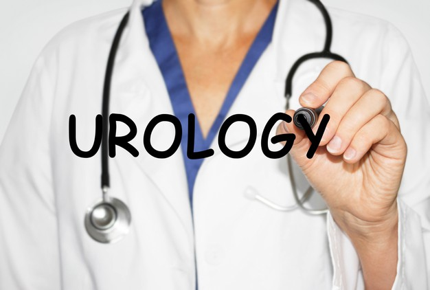 doctor-writing-word-urology-with-marker-medical-concept_132358-2563