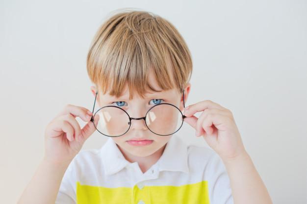 handsome-teen-boy-wears-glasses-poor-vision-medicine-concept_154317-501