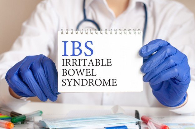 ibs-card-hands-medical-doctor-doctor-s-hands-blue-gloves-holding-sheet-paper-with-text-ibs-short-irritable-bowel-syndrome-medical-concept_384017-440