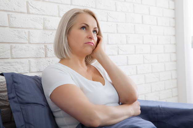 sad-woman-sitting-bed-morning-depressed-menopause_199352-71 (1)