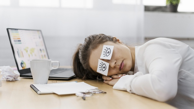 tired-businesswoman-covering-her-eyes-with-drawn-eyes-paper_23-2148813192