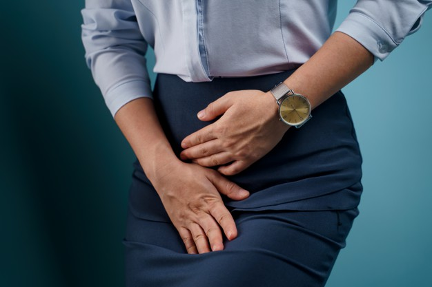 woman-having-painful-holding-hands-pressing-her-crotch-lower-abdomen_105092-1197